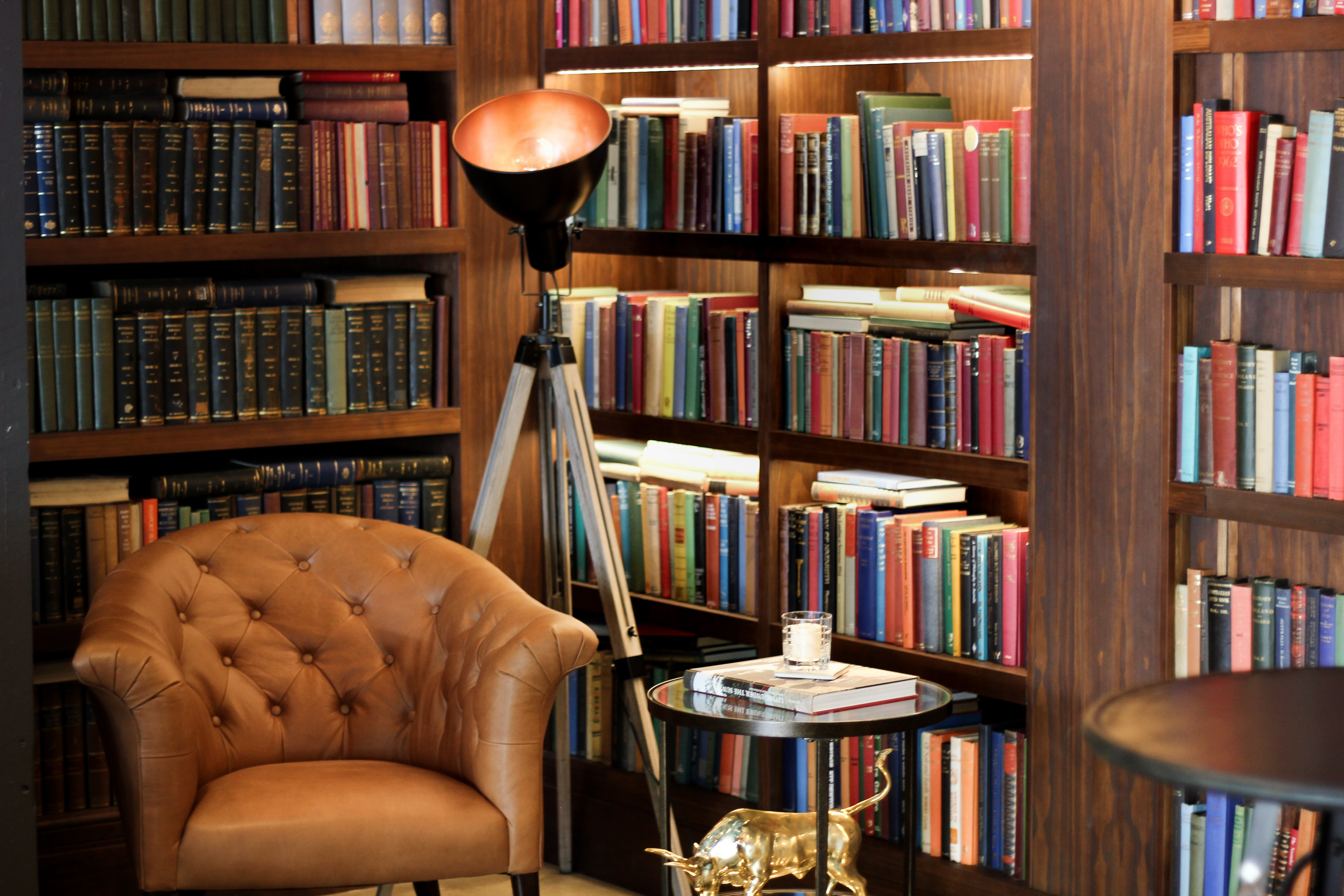 Woolloongabba Real estate office with Arm Chair & Books