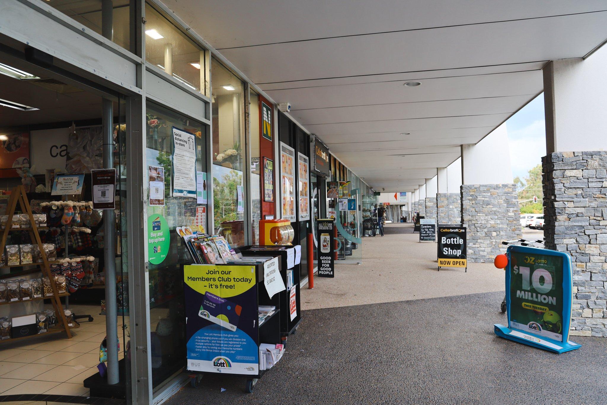 Eastside Village shops, including a newsagency and a cafe