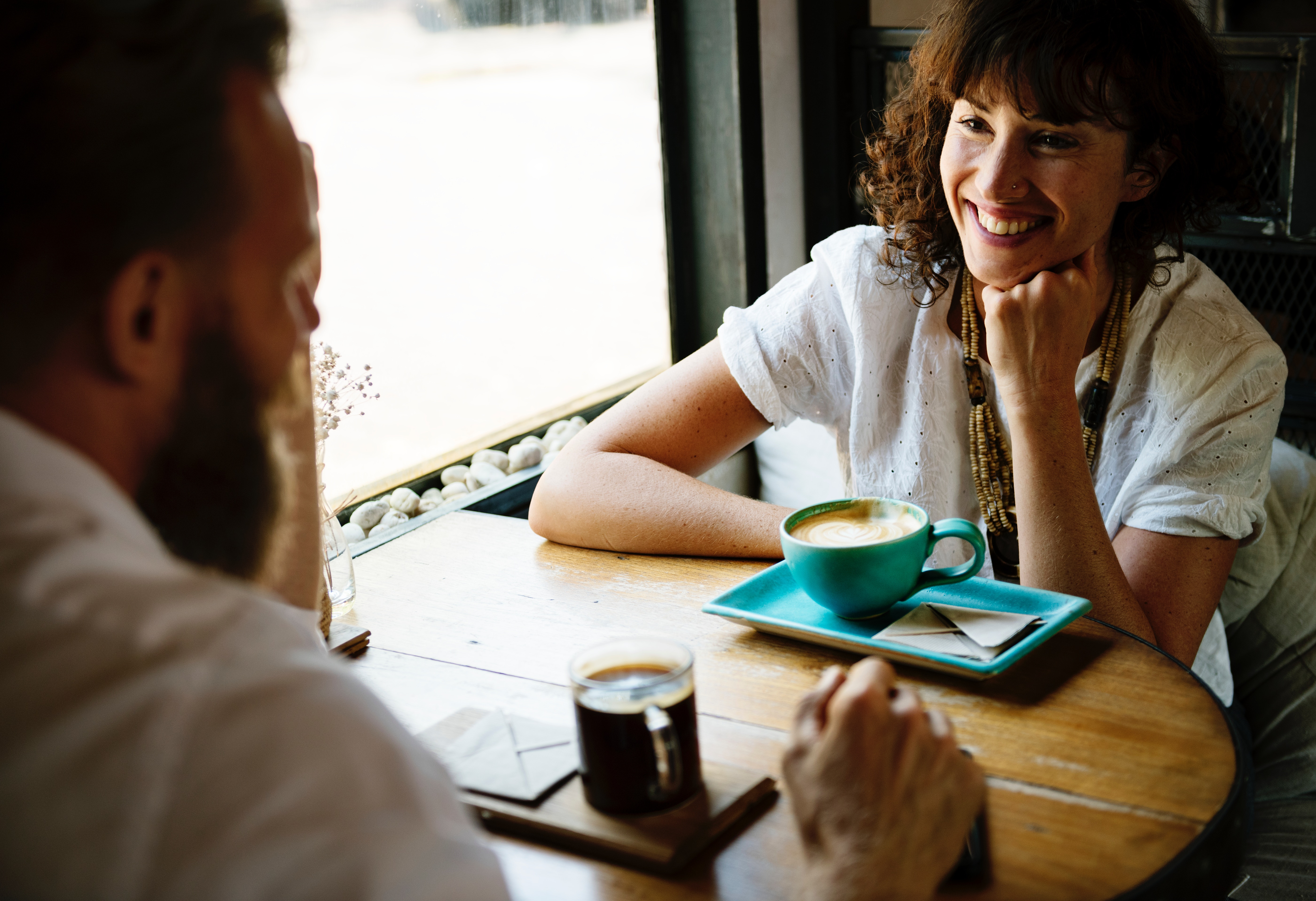 man and woman having a meeting in a coffee shop