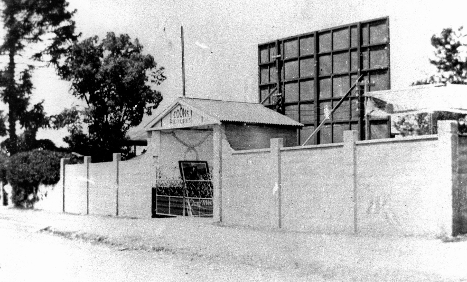 Cinema with fence and Cook's Theatre sign | Image: Oxley-Chelmer History Group