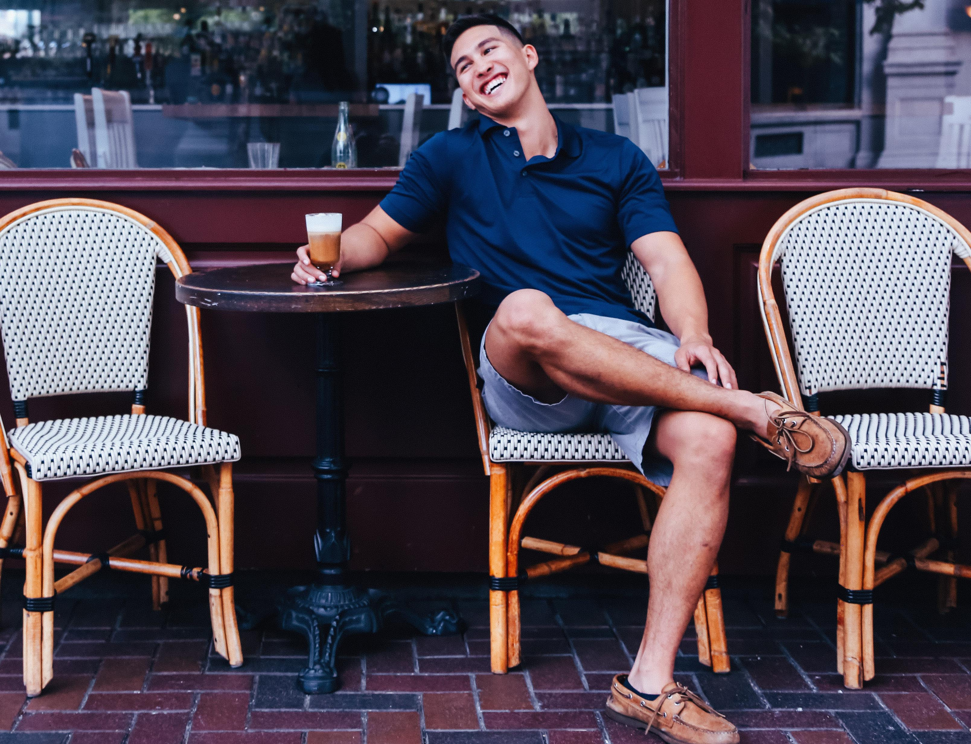 happy man in front of cafe