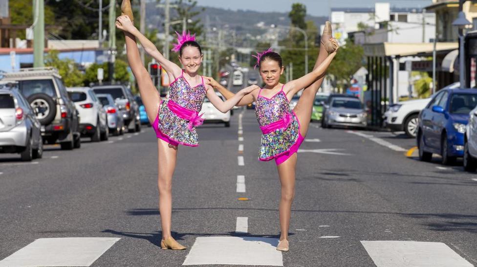 two girls dancing in Sherwood street